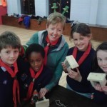 Cub leader Caroline O'Brien with cubs who had finished their bird feeders