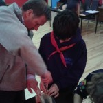 Cub Leader Ciaran Cassidy gives a helping hand .Awkard at times!